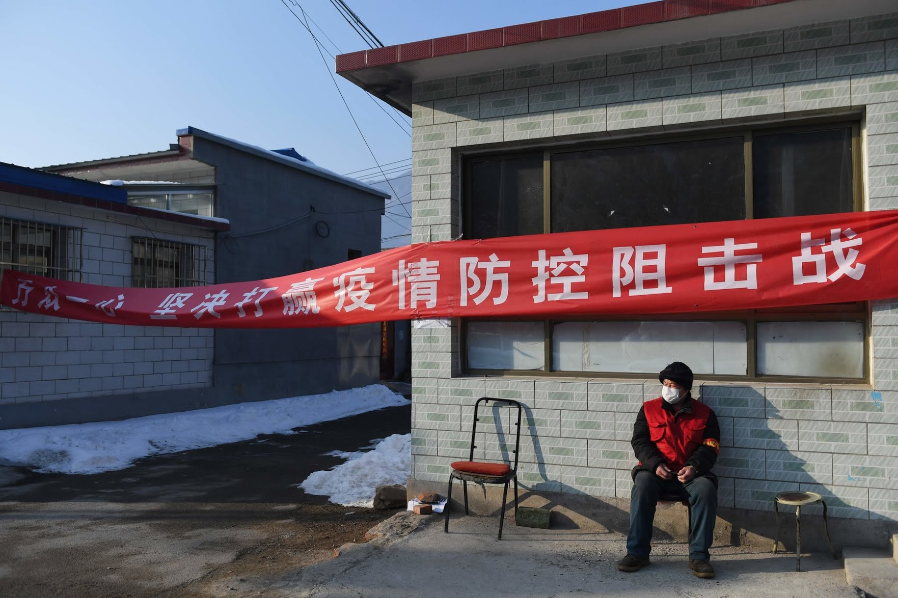 "A propaganda banner north of Beijing declared: ""Work together to decisively win the fight against the epidemic."""
