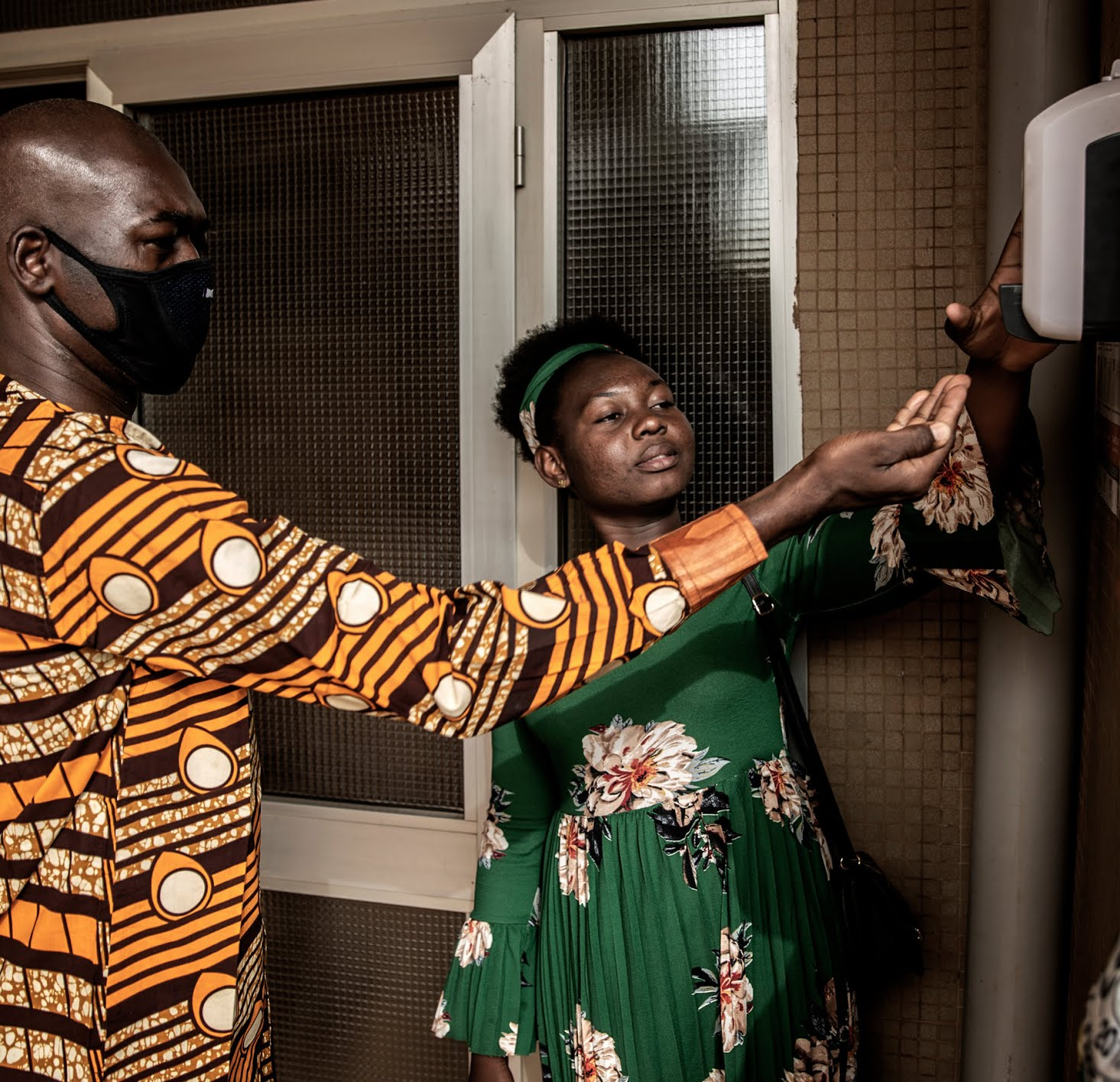 Using hand sanitizer before entering the Assemblies of God Church in Burkina Faso's capital, Ouagadougou, in March.