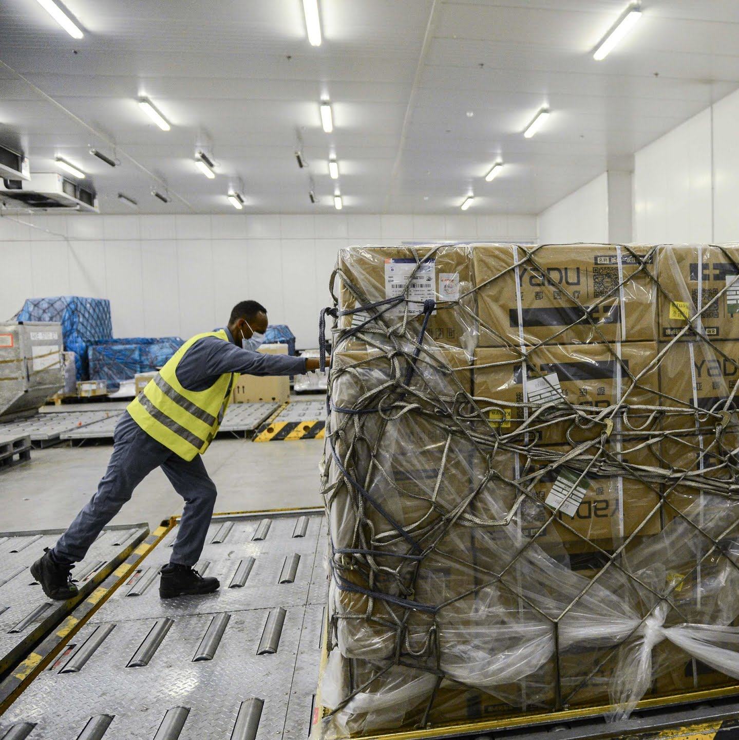 Moving boxes of protective equipment at Bole International Airport in Addis Ababa.