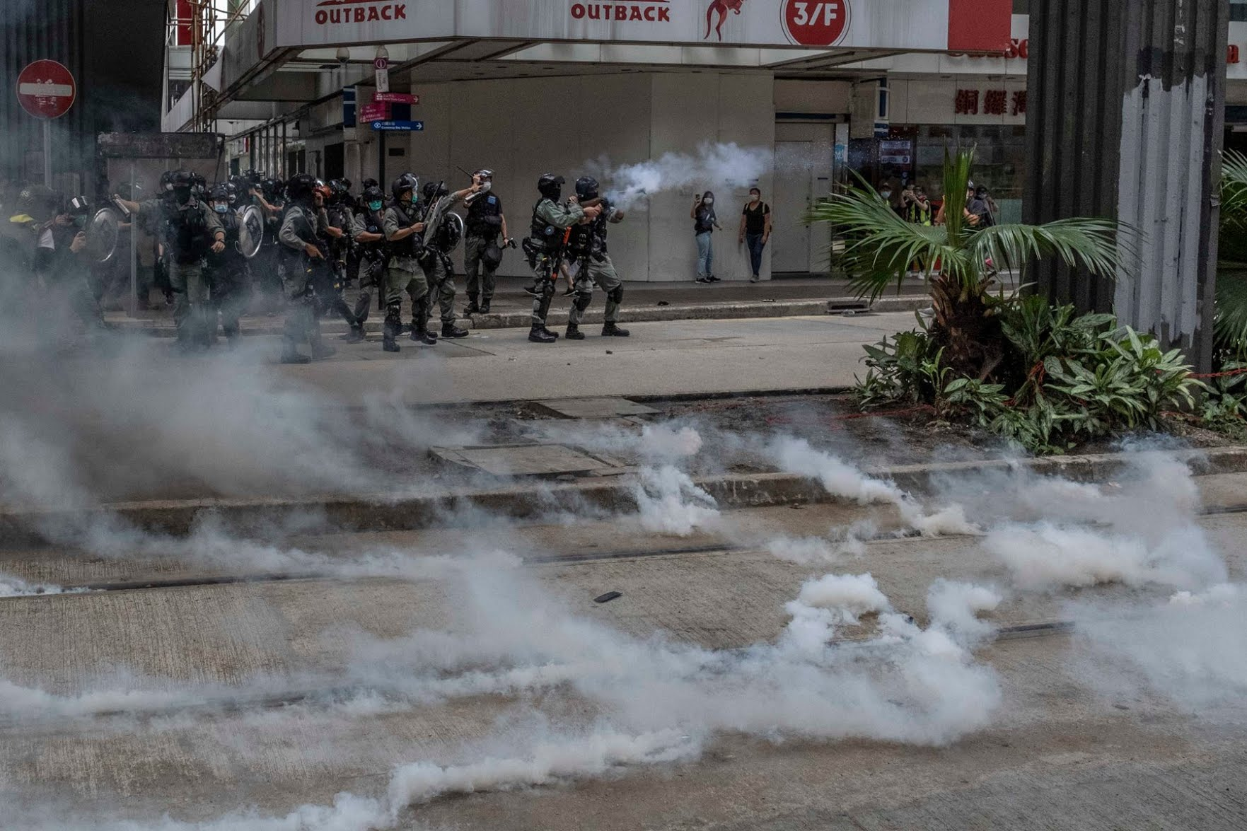 Police officers fired tear gas to disperse protesters in Hong Kong on Sunday.