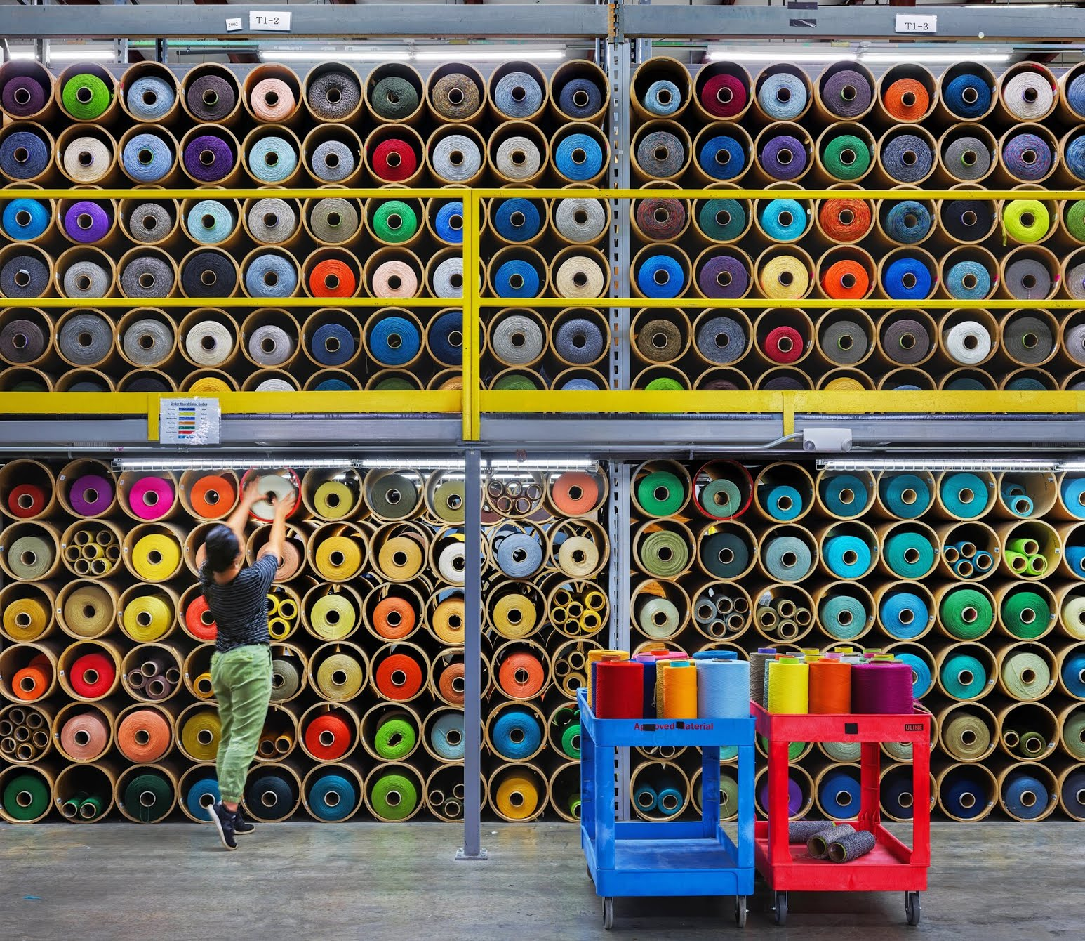 Spools of yarn at Interface. Materials and processing account for a majority of the CO2 emissions associated with making carpet.