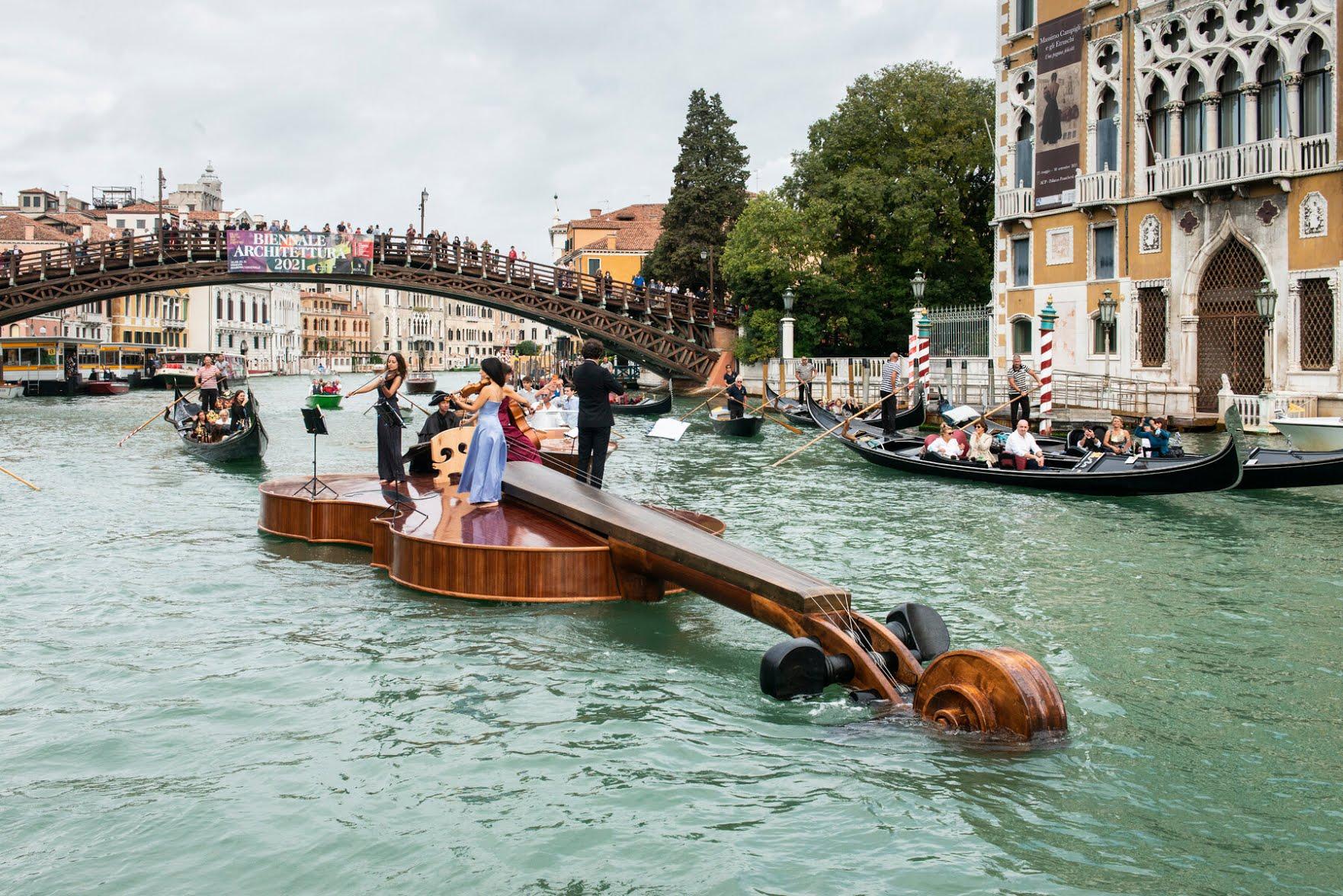 Musicians played Vivaldi atop the artist Livio De Marchi's floating violin in the Grand Canal in Venice.