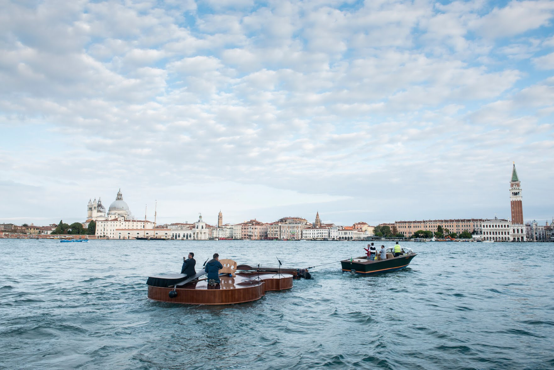 De Marchi's floating violin on its way to the Grand Canal.